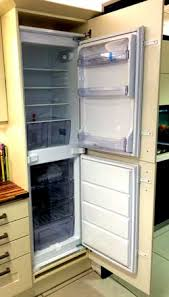 gap between fridge and cabinets my integrated fridge freezer doors do not line up with the kitchen