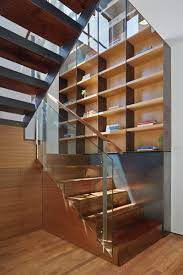 Plywood Stairs Design 12 Inspiring Examples Of Staircases With Bookshelves Contemporist