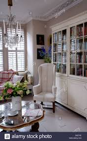 flower arrangement on antique table in living room with white