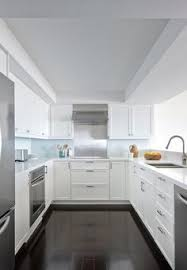 modern kitchens white grey modern kitchen with handleless cabinetry and pink splashback