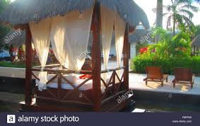 the beautiful bali style daybeds at a resort and spa in cancun