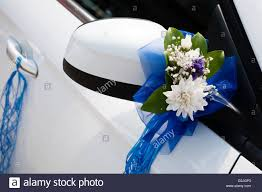 wedding car decorations wedding car decoration with flowers and ribbons stock photo