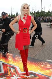 rita ora tries to upstage cheryl in bold red dress and thigh high