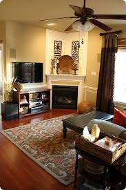 living rooms with corner fireplaces decorating condo living room with corner mantle meliving