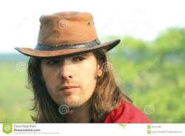 portrait of guy with in cowboy hat country style safari romance