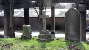 pictures of tombstones static of tombstones and cross with a car traffic in the