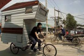 tiny trailer pulled by bicycle rider may really be the smallest
