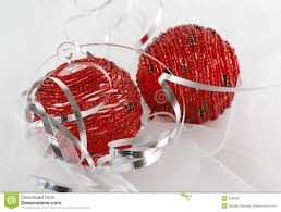 two red beaded christmas ornaments with silver ribbon royalty free
