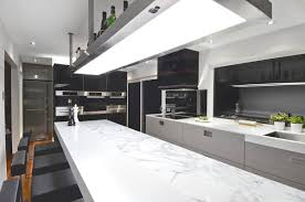 minimalsit kitchen design with marble bar table and four black