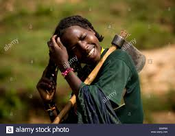 portrait of a young borana tribe lumberjack woman tidying her hair