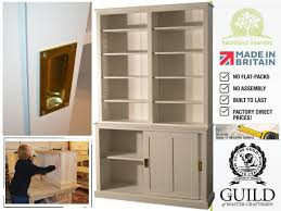contemporary white painted 220cm tall bookcase with sliding doors