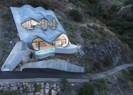 a futuristic spanish home perched on a cliff offers stunning views
