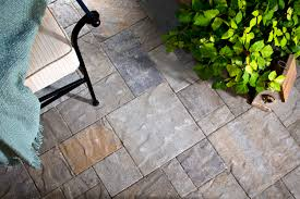 How To Lay Patio Pavers On Dirt by Stamped Concrete Vs Paving Stones Comparison Guide Install It