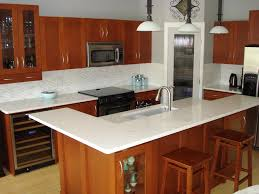 delectable white color kitchen quartz countertops with brown color