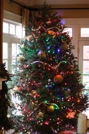 white christmas tree with multicolor lights white lights or multicolored lights for your christmas tree flocked