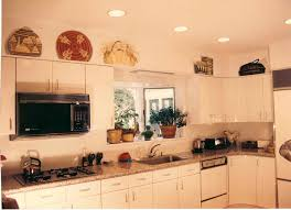 Above Kitchen Cabinet Ideas Decorating Above Kitchen Cabinets With Baskets Deductour Com