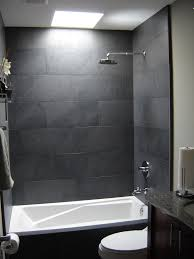 simple grey tile bathroom designs come with white ceramic bathtub