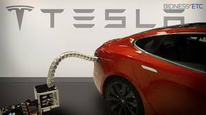 tesla charging tesla u0027s innovative car charger prototype is like a metal snake on