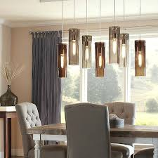 Dining Room Lights Contemporary Dining Room Lighting Chandelier Hung At Staggered Heights Luminous