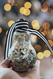 this is our bliss diy foil confetti pom pom filled light bulb