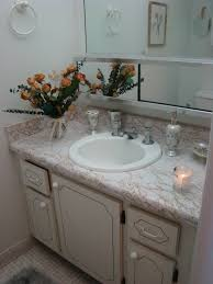 modern guest bathroom ideas white wooden vanity with marble top and round white sink plus
