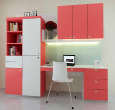 pink study room design with small pink white cupboard with white