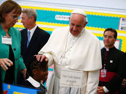 Pope Francis Goes to East Harlem  Gives Children      Some Homework     PHOTO  Pope Francis touches a students head as he visits Our Lady Queen of Angels