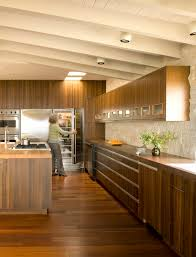 lighting on exposed beams alluring walnut cabinets home interior design midcentury kitchen