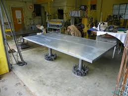 repurposed dining table zinc top dining tables crow s foot repurposed agricultural base