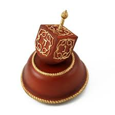 musical dreidel festive musical dreidel with wooden base and gold accents