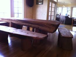 brown wood dining table with benches on brown wooden floor
