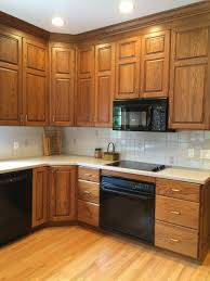 brown kitchen cabinets with backsplash how to make an oak kitchen cool again copper corners