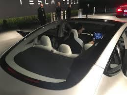 tesla inside tesla model s rear seats fold driving the tesla model s quickly