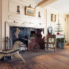 understated holiday decorating for an early home old house another feather tree and a swag of silver tinsel decorate the fireplace wall in