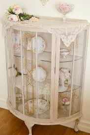 displaying china in a cabinet vintage shabby chic glass display