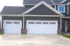 long panel carriage style white garage door in downs il with