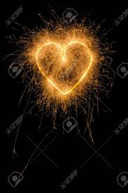 heart sparklers burning firework heart from sparklers stock photo picture and