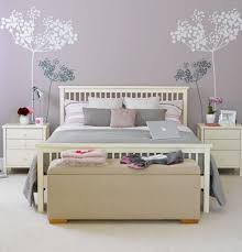 pastel purple wall color with beige tufted bench for nice bedroom