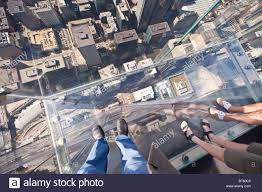 looking down in the skydeck at the sears now willis tower sky