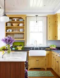 a kitchen with yellow cabinets and gray walls like ours if i had
