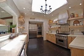 Rustic Kitchen Hoods - rustic kitchen with slate tile floors u0026 limestone zillow digs