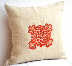 burlap pillows with obi inspired flower embroidery orange