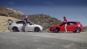 nissan 370z vs golf r video the new awd rivals golf r vs impreza wrx sti revved