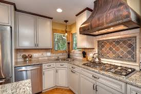 traditional kitchen backsplash brown tile backsplash kitchen traditional with beige cabinet beige