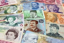 the many different faces of money from around the world stock photo
