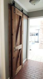 Sliding Barn Doors A Practical Solution For Large Or by How To Build And Hang A Barn Door For Around 20 Barn Doors