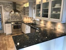 blue kitchen cabinets with granite countertops tips for matching countertops and cabinetry c and c stoneworks