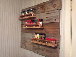 rustic spice rack with old wood and old copper pipe for the