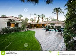 House Patio by Patio With Pool In Front Of Modern House Royalty Free Stock