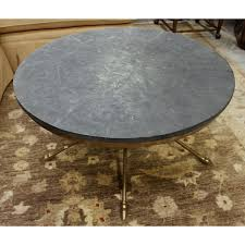 century round coffee table w crossed legs upscale consignment